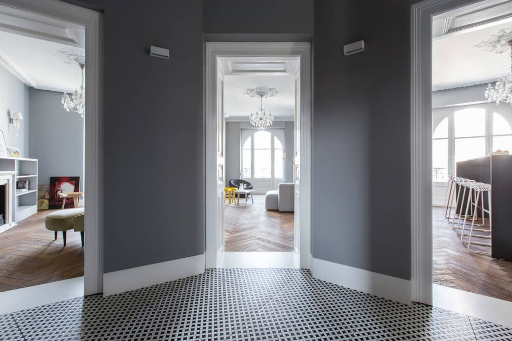 With A Floor As Beautiful The Chevron Patterned Dark Hardwood One In This Recently Renovated Classic Apartment Re Imagining Designers Main Job Is